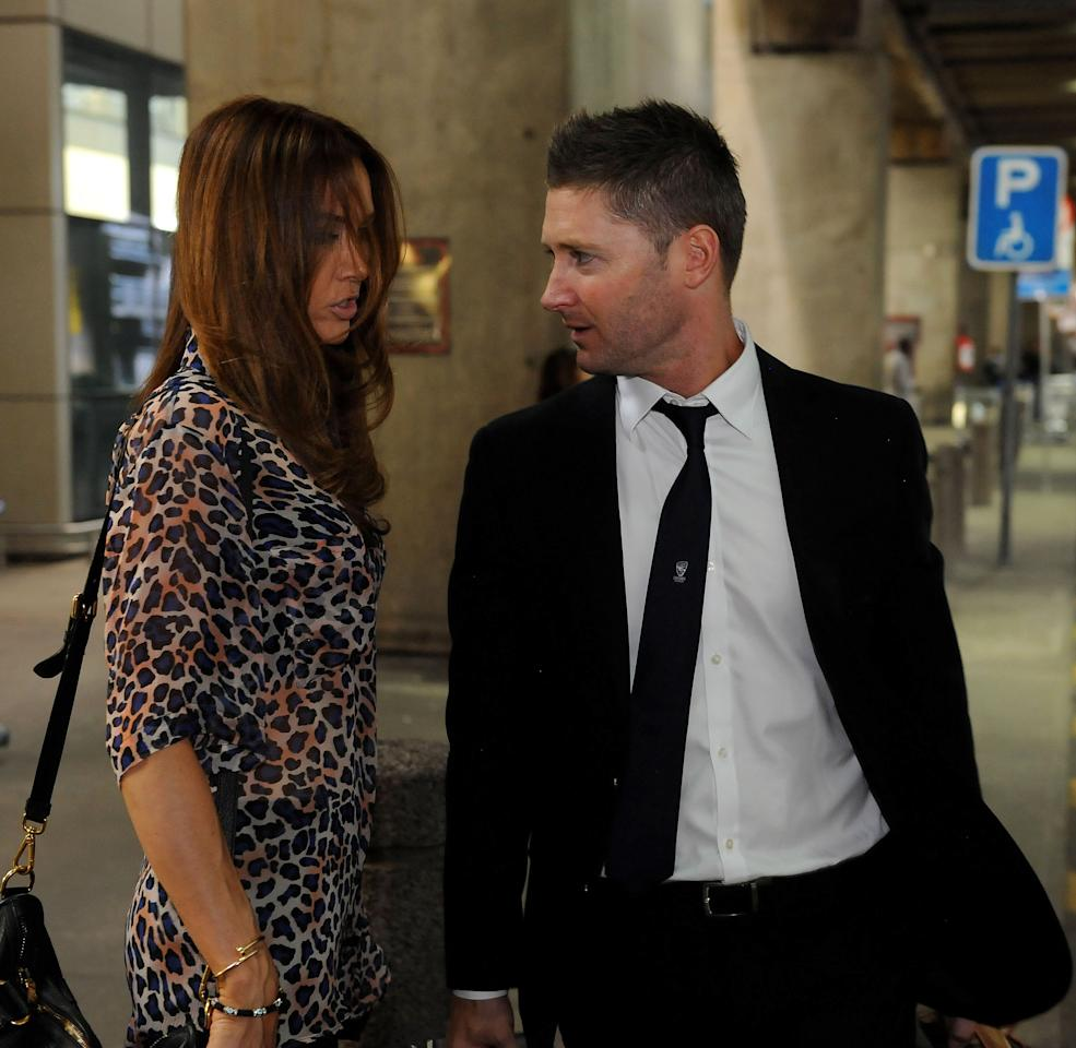 JOHANNESBURG, SOUTH AFRICA - JANUARY 29: (SOUTH AFRICA OUT) Captain Michael Clarke (R) of Australia's cricket team and his wife Kyly Clarke arrive at OR Tambo International Airport ahead off their three-test tour of South Africa on January 29, 2014 in Johannesburg, South Africa. (Photo by Duif du Toit/Gallo Images/Getty Images)