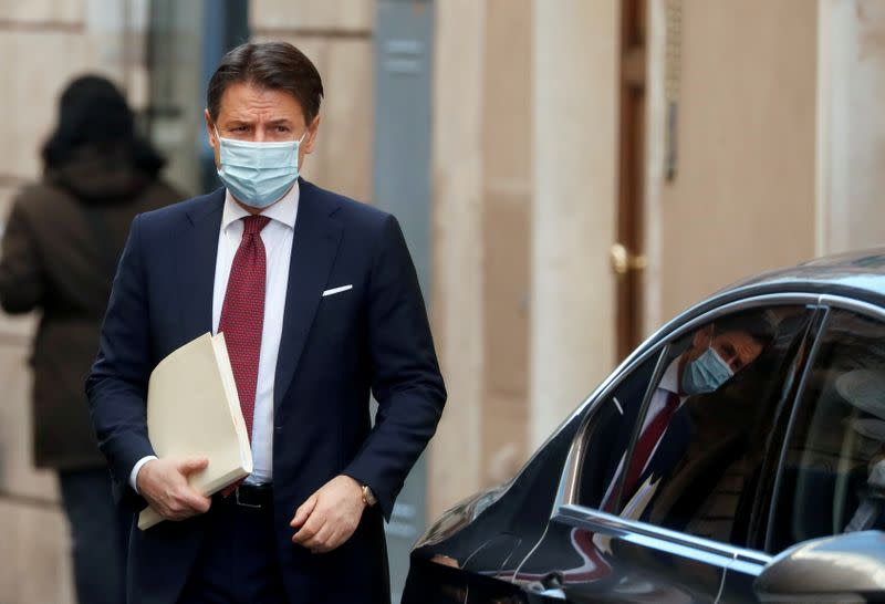 FILE PHOTO: Italy's caretaker Prime Minister Giuseppe Conte leaves his house