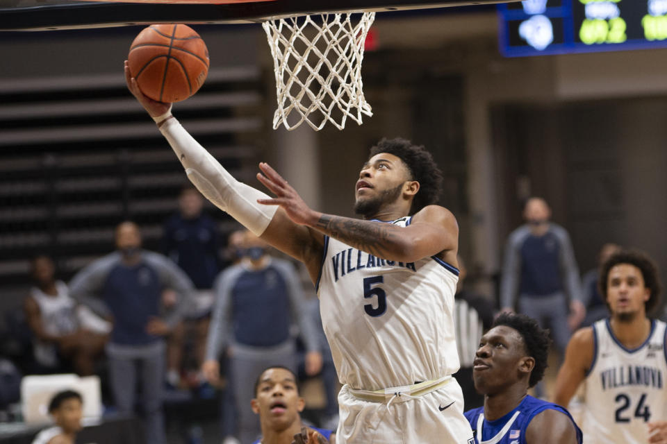 Villanova guard Justin Moore (5) makes a layup during the first half of an NCAA college basketball game against Seton Hall, Tuesday, Jan. 19, 2021, in Villanova, Pa. (AP Photo/Laurence Kesterson)