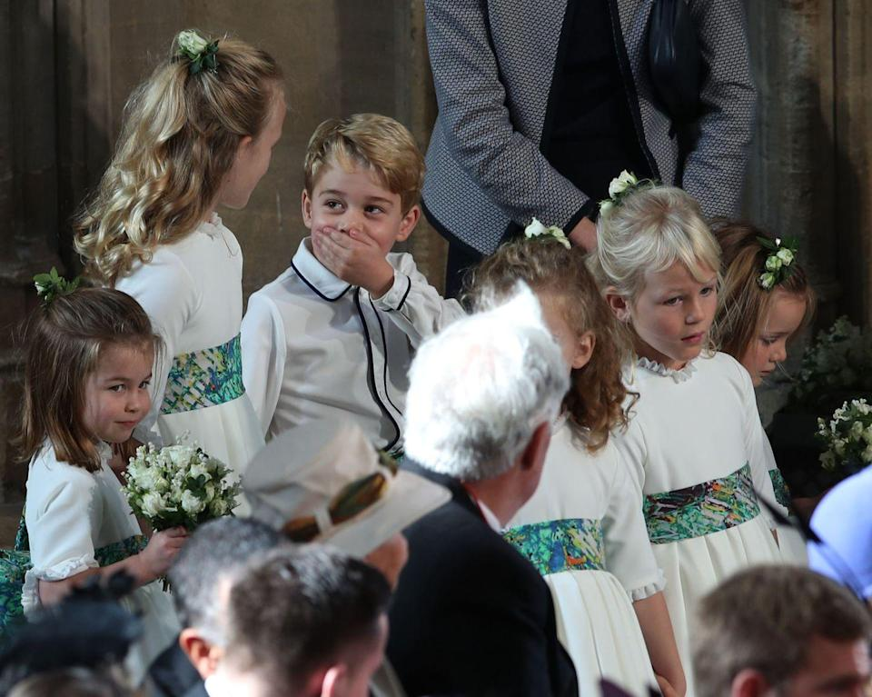 "<p>While it's far from a major scandal, Prince George was caught on camera looking exceedingly cheeky at <a href=""https://www.harpersbazaar.com/celebrity/latest/g23692122/princess-eugenie-royal-wedding-photos/"" rel=""nofollow noopener"" target=""_blank"" data-ylk=""slk:Princess Eugenie's wedding"" class=""link rapid-noclick-resp"">Princess Eugenie's wedding</a>. Snapped next to known <a href=""https://www.harpersbazaar.com/celebrity/latest/a23732776/prince-george-savannah-philips-eugenie-wedding/"" rel=""nofollow noopener"" target=""_blank"" data-ylk=""slk:troublemaker Savannah Phillips"" class=""link rapid-noclick-resp"">troublemaker Savannah Phillips</a>, George couldn't stop giggling right before the service, especially when his partner in crime pretended to play the trumpet. These two are too much. </p>"