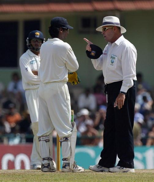 KANDY, SRI LANKA - DECEMBER 14:  Umpire Daryl Harper has a word with Kumar Sangakkara of Sri Lanka during the fifth day of the Second Test between Sri Lanka and England at the Asgiriya Stadium, on December 14 2003, in Kandy, Sri Lanka. (Photo by Tom Shaw/Getty Images)