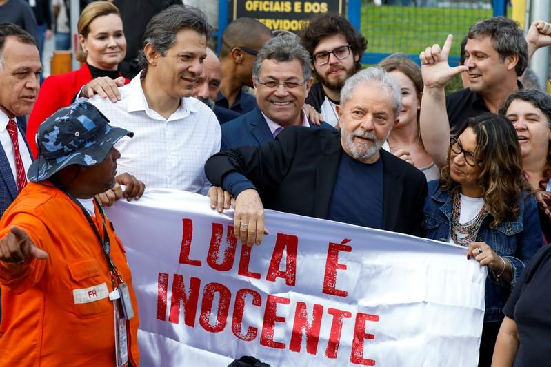 Former Brazilian President Luiz Inacio Lula da Silva walks out after being released from prison, in Curitiba