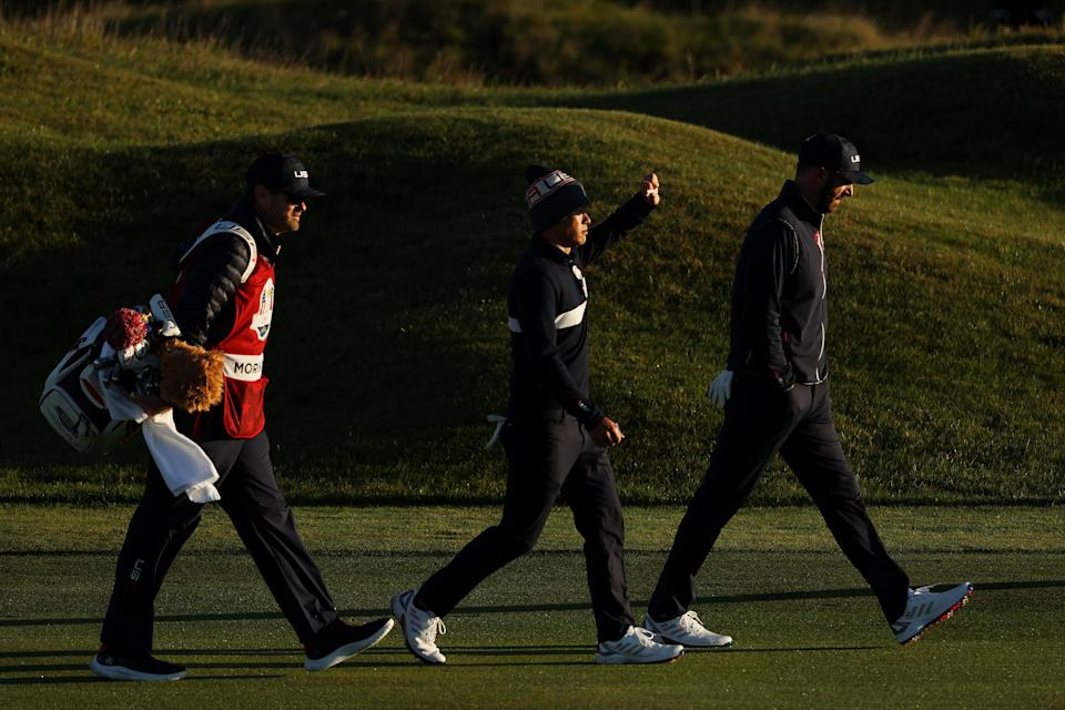 KOHLER, WISCONSIN - SEPTEMBER 25: Collin Morikawa of team United States (L) and Dustin Johnson of team United States walk down the first hole during Saturday Morning Foursome Matches of the 43rd Ryder Cup at Whistling Straits on September 25, 2021 in Kohler, Wisconsin. (Photo by Warren Little/Getty Images)