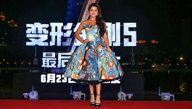 Isabela Moner wore a Transformers-inspired dress to the word premiere of 'Transformers: The Last Knight.' (Photo: Getty Images)