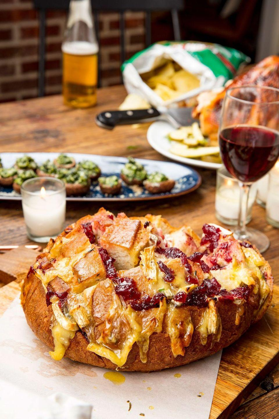 """<p>Watch your friends and family fight over this sweet and savory pull-apart bread made from scratch. </p><p><em><strong>Get the recipe from <a href=""""https://www.delish.com/cooking/recipe-ideas/recipes/a57209/cranberry-brie-pull-apart-bread-recipe/"""" rel=""""nofollow noopener"""" target=""""_blank"""" data-ylk=""""slk:Delish"""" class=""""link rapid-noclick-resp"""">Delish</a>.</strong></em><em><br></em></p>"""