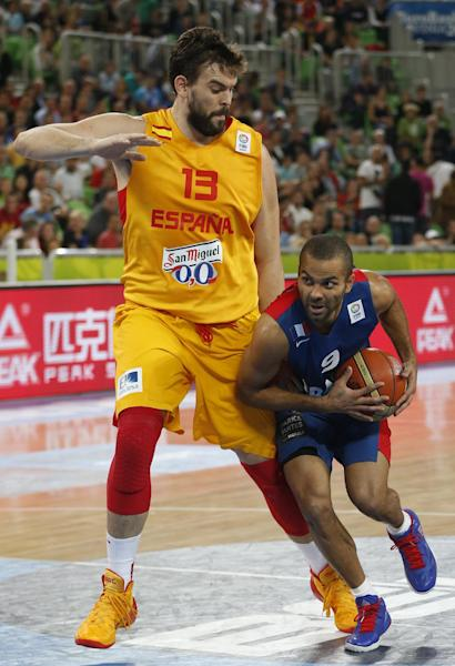 Spain's Marc Gasol, left, tries to stop France's Tony Parker, right, during their EuroBasket European Basketball Championship semifinal match in Ljubljana, Slovenia, Friday, Sept. 20, 2013. (AP Photo/Petr David Josek)