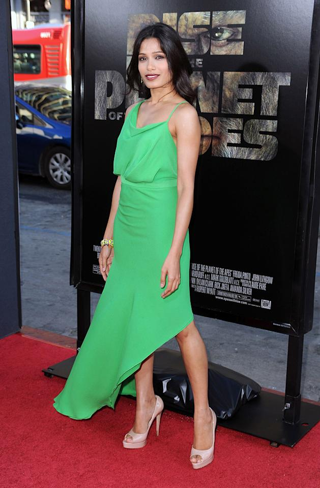 "Freida Pinto's asymmetrical Juan Carlos Obando dress wonderfully accents her skin tone and raven black hair at the Los Angeles premiere of ""Rise of the Planet of the Apes"" on July 28, 2011."