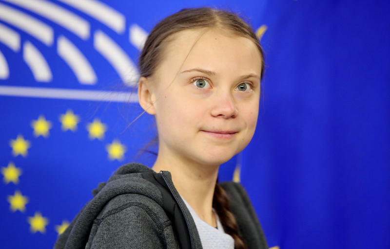 Swedish climate activist Greta Thunberg arrives for a meeting of the Environment Council at the European Parliament in Brussels, Wednesday, March 4, 2020. Climate activists and Green members of the European Parliament are urging the European Union to be more ambitious as the bloc gets ready to unveil plans for a climate law to cut greenhouse gas emissions to zero by mid-century. (AP Photo/Olivier Matthys)