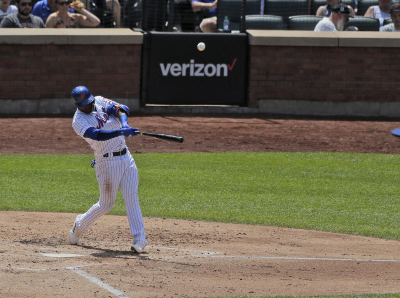 New York Mets' Adeiny Hechavarria hits a three-run home run during the fourth inning of a baseball game against the Detroit Tigers at Citi Field, Sunday, May 26, 2019, in New York. (AP Photo/Seth Wenig)