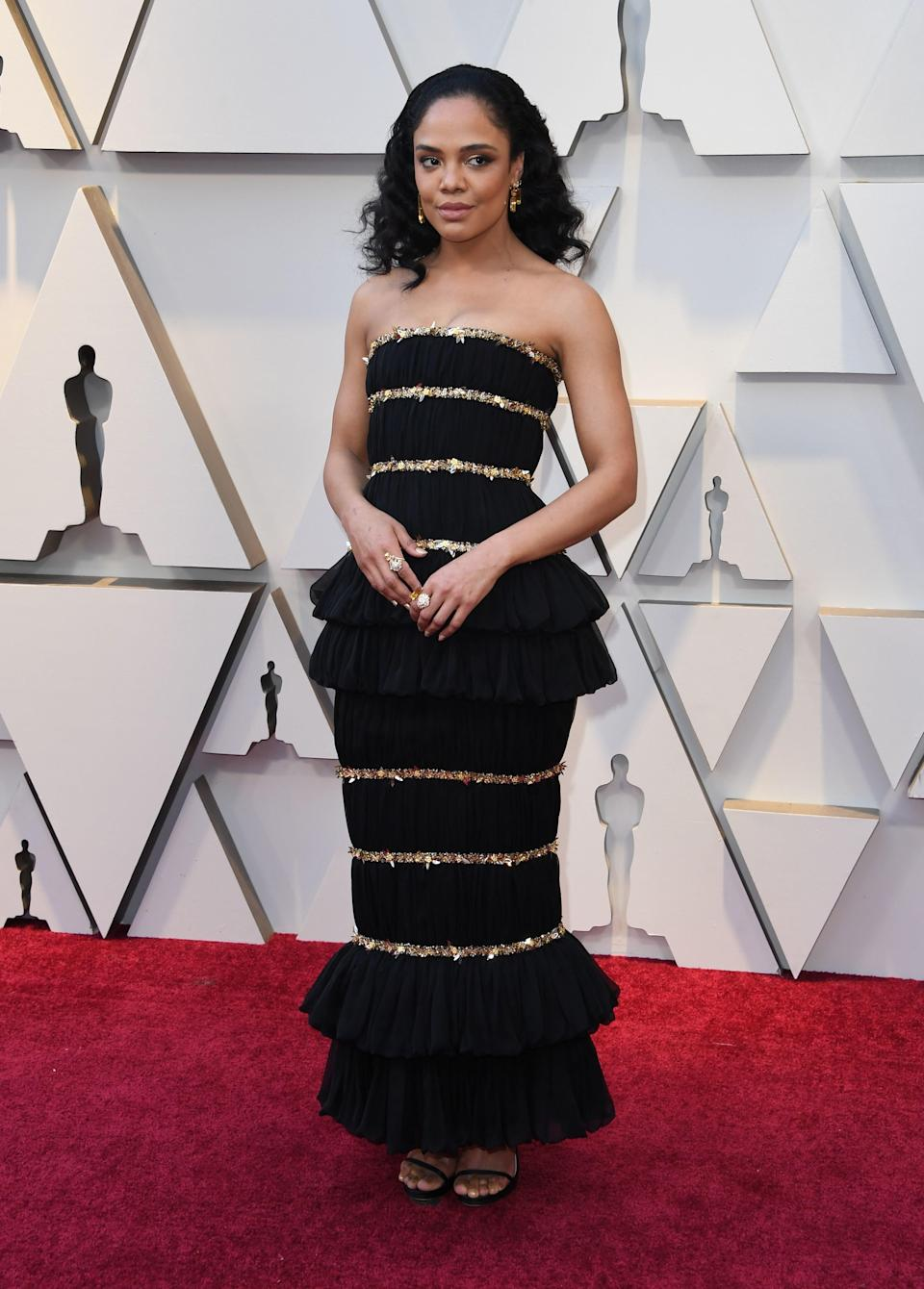Tessa Thompson in Chanel Couture, Chanel jewelry and Jimmy Choo heels