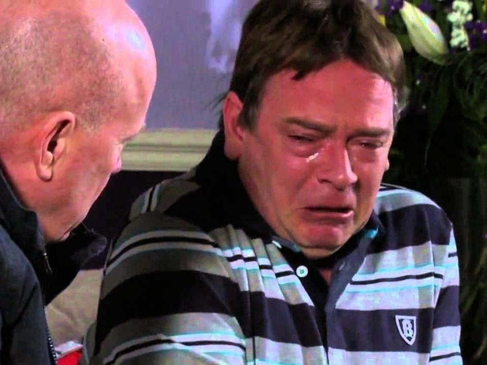 Ian Beale is comforted by Phil Mitchell in 'EastEnders': BBC
