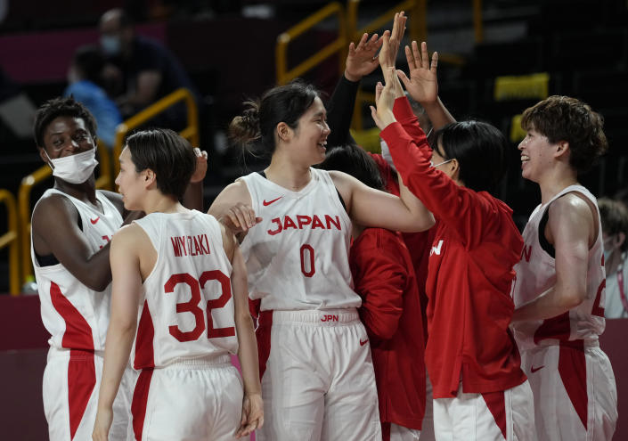 Japan players celebrate their win in the women's basketball preliminary round game against France at the 2020 Summer Olympics, Tuesday, July 27, 2021, in Saitama, Japan. (AP Photo/Eric Gay)