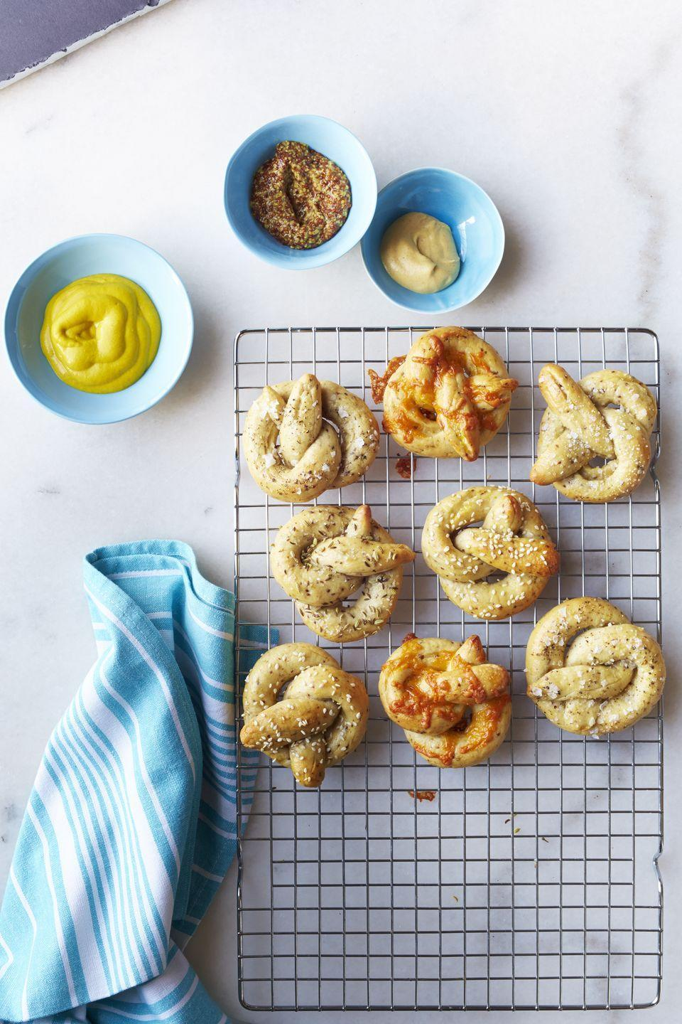 "<p>These warm pretzels will become a fan favorite when paired with several tasty dips. </p><p><strong><a href=""https://www.countryliving.com/food-drinks/recipes/a32522/grainy-mustard-soft-pretzels-recipe-wdy1014/"" rel=""nofollow noopener"" target=""_blank"" data-ylk=""slk:Get the recipe"" class=""link rapid-noclick-resp"">Get the recipe</a>.</strong></p>"