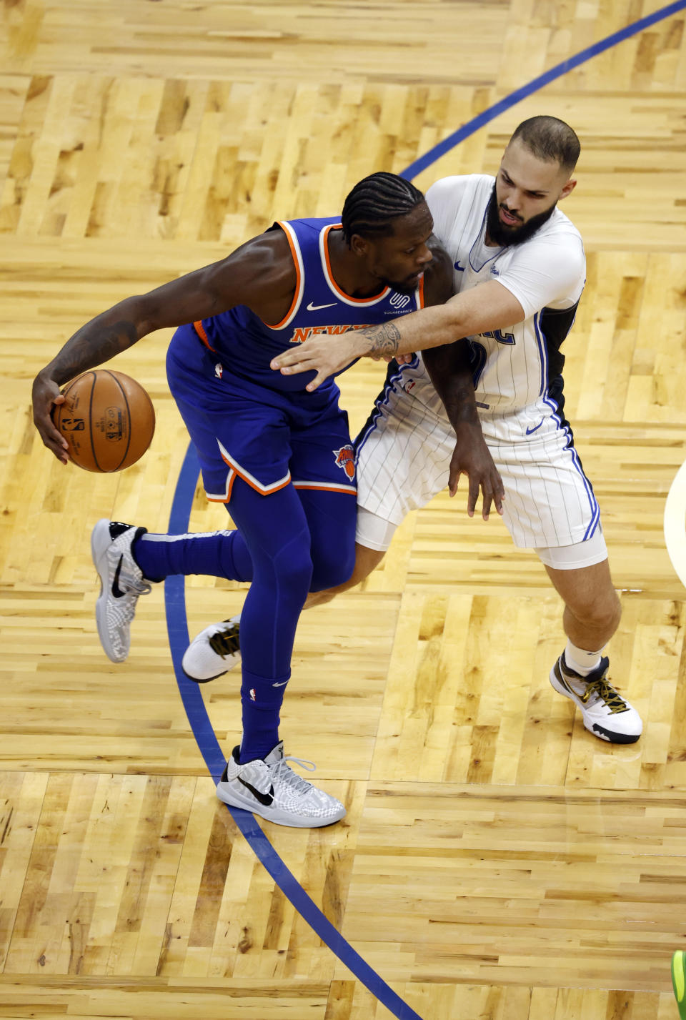 Feb 17, 2021; Orlando, Florida, USA; New York Knicks forward Julius Randle (30) moves to the basket as Orlando Magic guard Evan Fournier (10) defends during the first quarter at Amway Center. Mandatory Credit: Kim Klement-USA TODAY Sports