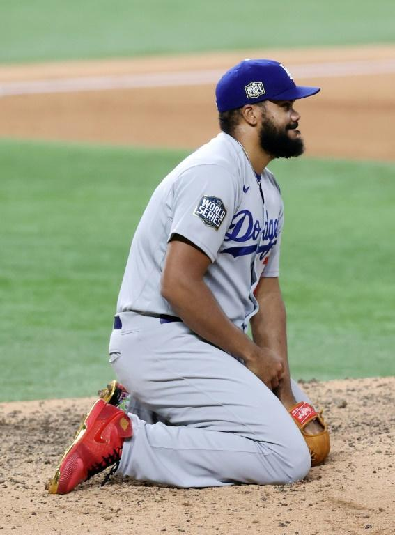 Los Angeles Dodgers pitcher Kenley Jansen reacts after giving up the game-winning single to Brett Phillips of the Tampa Bay Rays in game four of the World Series