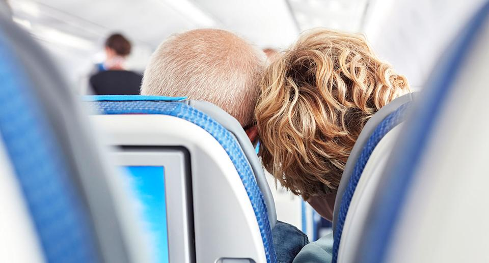A man, posed by model, has gone viral for a sweet gesture on a plane. [Photo: Getty]