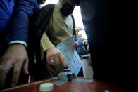 Populist Shiite cleric Muqtada al-Sadr casts his vote during parliamentary elections in Najaf, Iraq, Sunday, Oct. 10, 2021. Iraq closed its airspace and land border crossings on Sunday as voters headed to the polls to elect a parliament that many hope will deliver much needed reforms after decades of conflict and mismanagement. (AP Photo/Anmar Khalil)