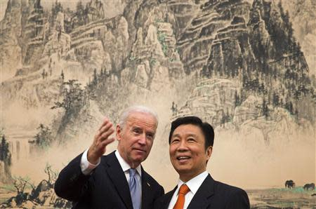 U.S. Vice President Biden chats with Chinese Vice Premier Li at the Diaoyutai State Guesthouse in Beijing