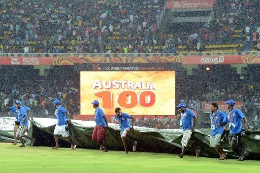Ground staff at the Premadasa Stadium in Colombo cover the pitch as rain stops play during the World Twenty20 on September 22. In Colombo, Australia were 100-1 in 9.1 overs chasing West Indies' total of 191-8 when heavy rain forced the match to be called off in front of 18,000 fans