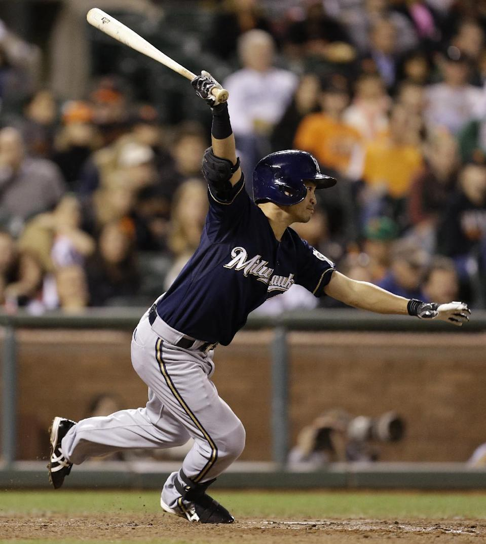 Milwaukee Brewers' Norichika Aoki, of Japan, swings for a two run single off San Francisco Giants' Santiago Casilla in the eighth inning of a baseball game Wednesday, Aug. 7, 2013, in San Francisco. (AP Photo/Ben Margot)