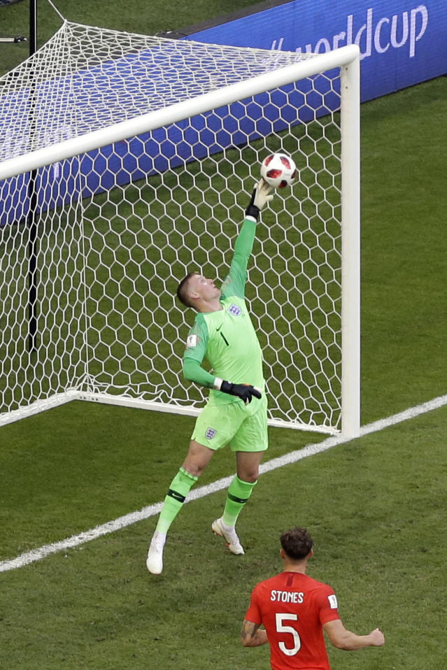 England goalkeeper Jordan Pickford stops a shot from Sweden's Marcus Berg during the quarterfinal match between Sweden and England at the 2018 soccer World Cup in the Samara Arena, in Samara, Russia, Saturday, July 7, 2018. (AP Photo/Thanassis Stavrakis)
