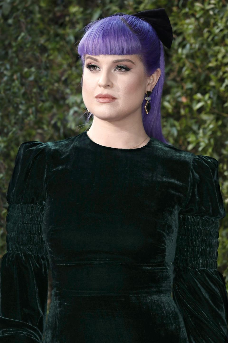 """<p>In 2010, Kelly Osbourne revealed that she'd be having the majority of the 15 tattoos she had at the time removed, citing <a href=""""https://www.usmagazine.com/stylish/news/kelly-osbourne-why-im-removing-most-of-my-15-tattoos-2010610/"""" class=""""link rapid-noclick-resp"""" rel=""""nofollow noopener"""" target=""""_blank"""" data-ylk=""""slk:some of them simply had no deeper meaning"""">some of them simply had no deeper meaning</a>. """"I was miserable and I just went and got all these tattoos and I don't know why,"""" she said. """"One of them is a keyboard and I don't even know how to play a piano!""""</p> <p>The star added: """"As you get older, you realize that you don't want to be defined by your tattoos, because that's not the type of person that I am.""""</p> <p>That was 10 years ago, but Osbourne isn't quite done with the removal process yet. Last year, <a href=""""https://www.instagram.com/p/CGDpyeHFsHT/"""" class=""""link rapid-noclick-resp"""" rel=""""nofollow noopener"""" target=""""_blank"""" data-ylk=""""slk:she shared an Instagram gallery"""">she shared an Instagram gallery</a> showing the process of her getting two of the tattoos removed: the aforementioned piano and the word """"lovely"""" written in cursive.</p> <p>""""Who else knows how bad this hurts,"""" the caption reads. """"It's 1000000000000 times worse then getting the tattoo!!!""""</p>"""