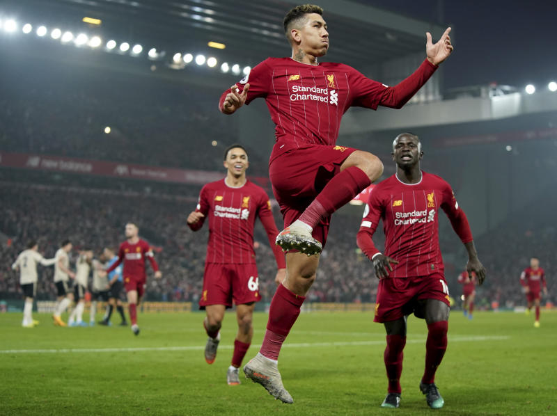 Liverpool's Roberto Firmino celebrates after a disallowed goal during the English Premier League soccer match between Liverpool and Manchester United at Anfield Stadium in Liverpool, Sunday, Jan. 19, 2020.(AP Photo/Jon Super)