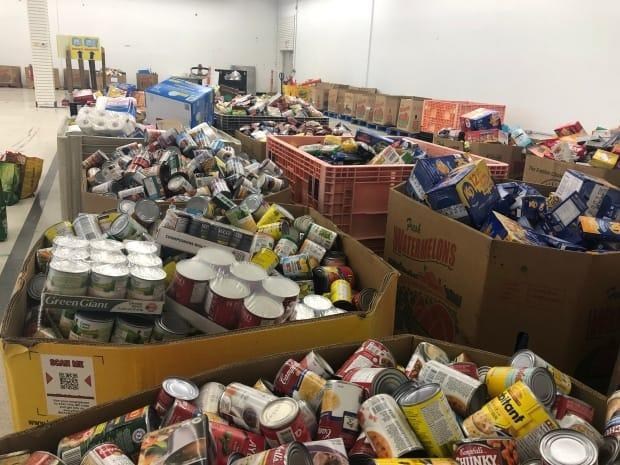 Food sorted into bins at the Roundhouse Centre warehouse hub for the second annual June 27 Miracle drive. (Jennifer La Grassa/CBC - image credit)