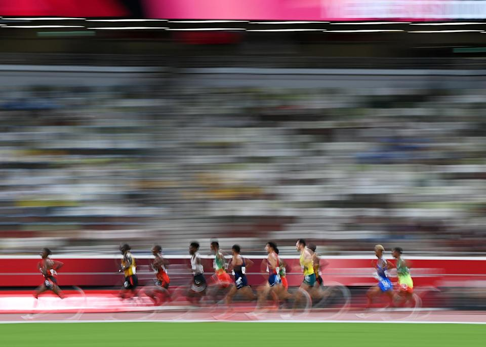 <p>Competitors race in the men's 10000m final on day seven of the Tokyo Olympics.</p>