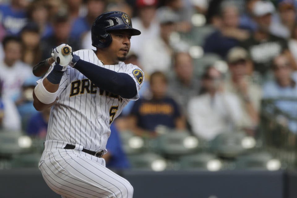 Milwaukee Brewers' Eduardo Escobar watches his two-RBI single during the second inning of a baseball game against the New York Mets, Sunday, Sept. 26, 2021, in Milwaukee. (AP Photo/Aaron Gash)