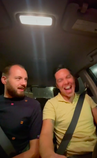 they're laughing in the car