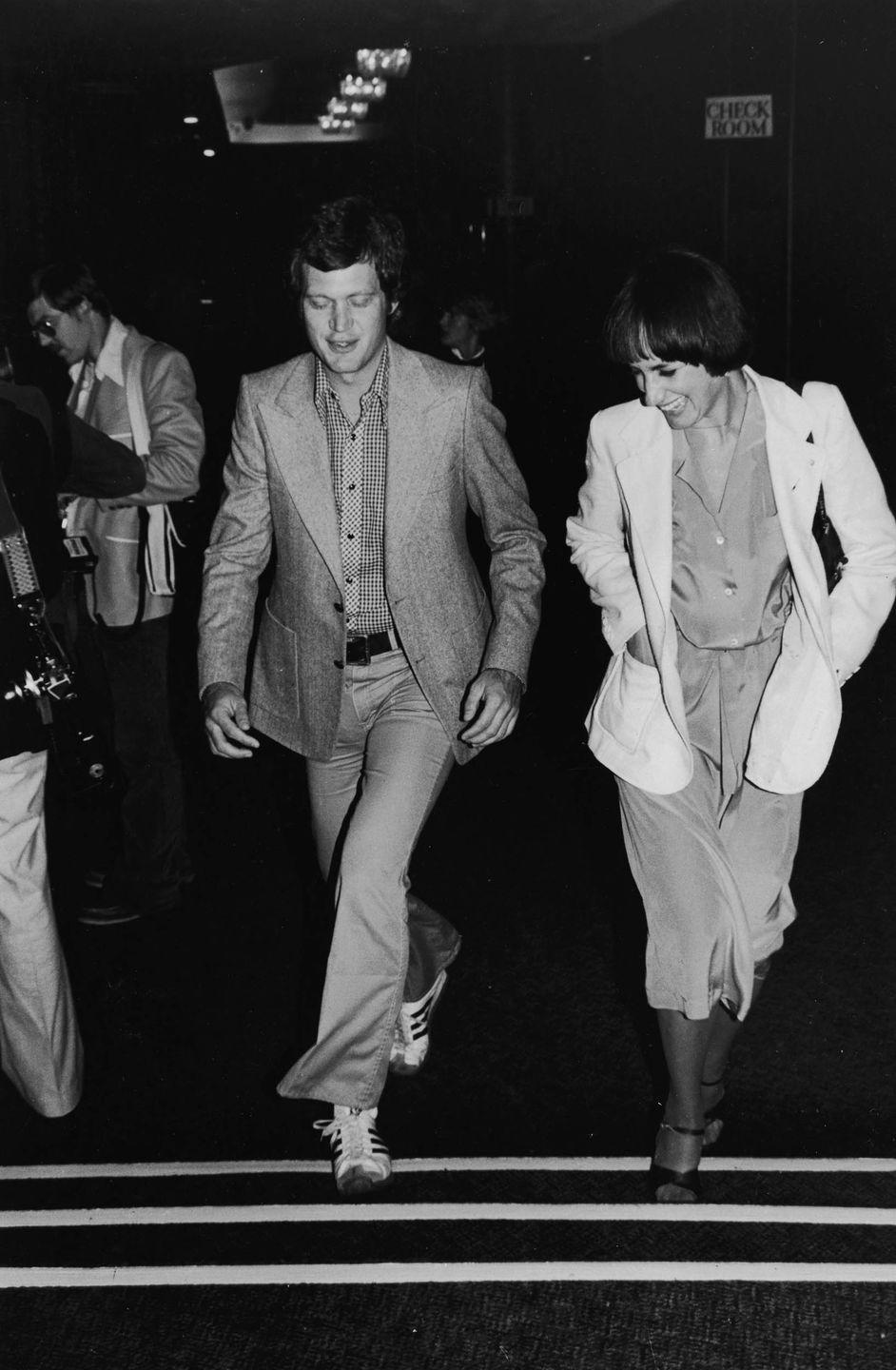 <p>David Letterman walks with Merrill Markoe during a S.H.A.R.E. party at the Hollywood Palladium on May 19, 1979.</p>