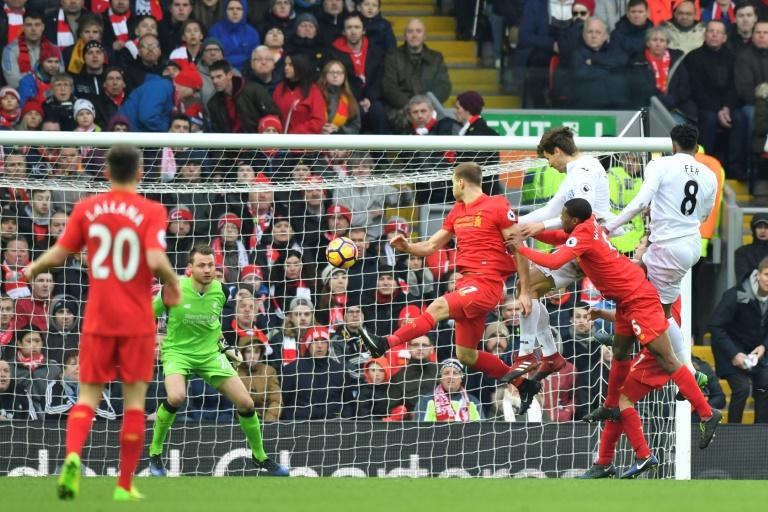 Swansea City's striker Fernando Llorente (3rdR) rises high to head the ball and score against Liverpool on January 21, 2017