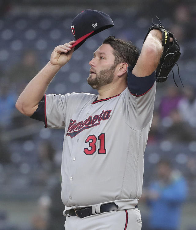 Minnesota Twins pitcher Lance Lynn (31) adjusts his cap between pitches against New York Yankees' Giancarlo Stanton during the first inning of a baseball game, Wednesday, April 25, 2018, in New York. (AP Photo/Julie Jacobson)