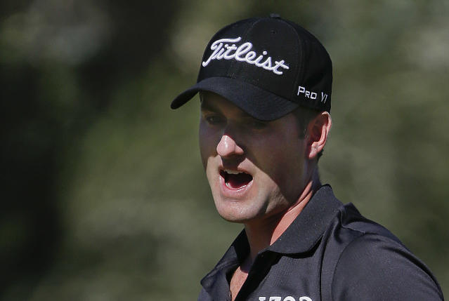 Webb Simpson reacts after missing a putt on the fourth green during the final round of the STPC Summerlin, Sunday, Oct. 20, 2013, in Las Vegas. Simpson won the tournament finishing 24-under 260. (AP Photo/Julie Jacobson)