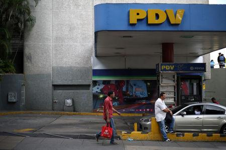 FILE PHOTO: A pedestrian walks next to a PDVSA gas station in Caracas, Venezuela, January 28, 2019. REUTERS/Andres Martinez Casares/File Photo