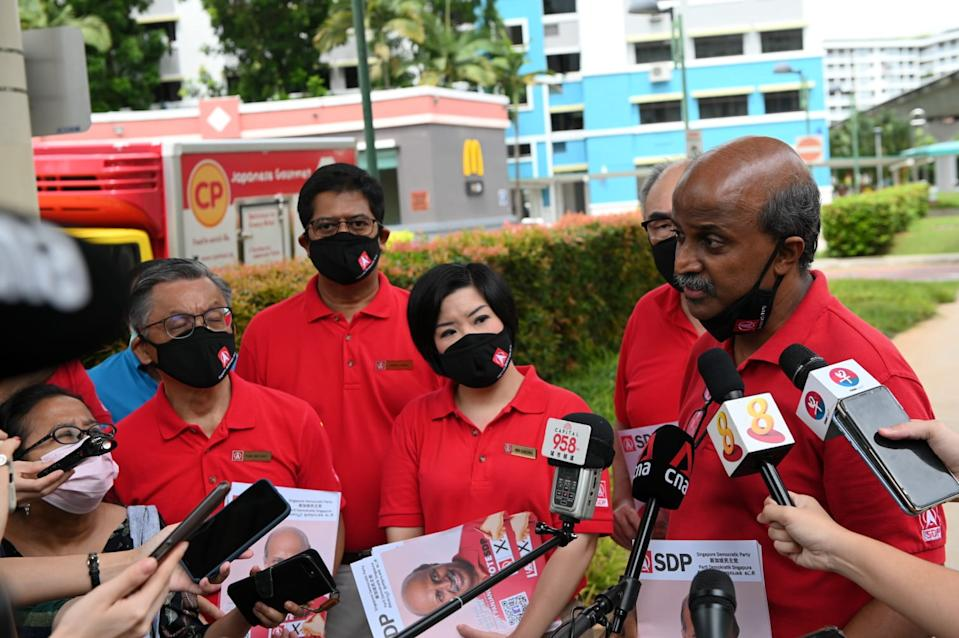 Singapore Democratic Party's members speaking to the media on 8 July. (PHOTO: Yahoo News Singapore/Joseph Nair)