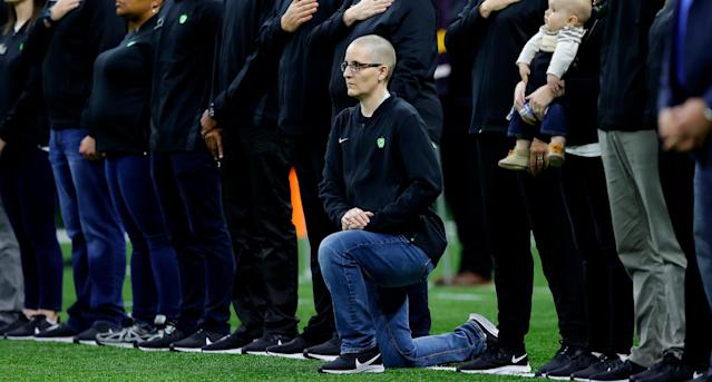"""Teacher of the Year"" Kelly Holstine kneeled during the National Anthem at the College Football Playoff National Championship game on January 13, with President and Melania Trump in attendance. (Photo: Getty Images)"
