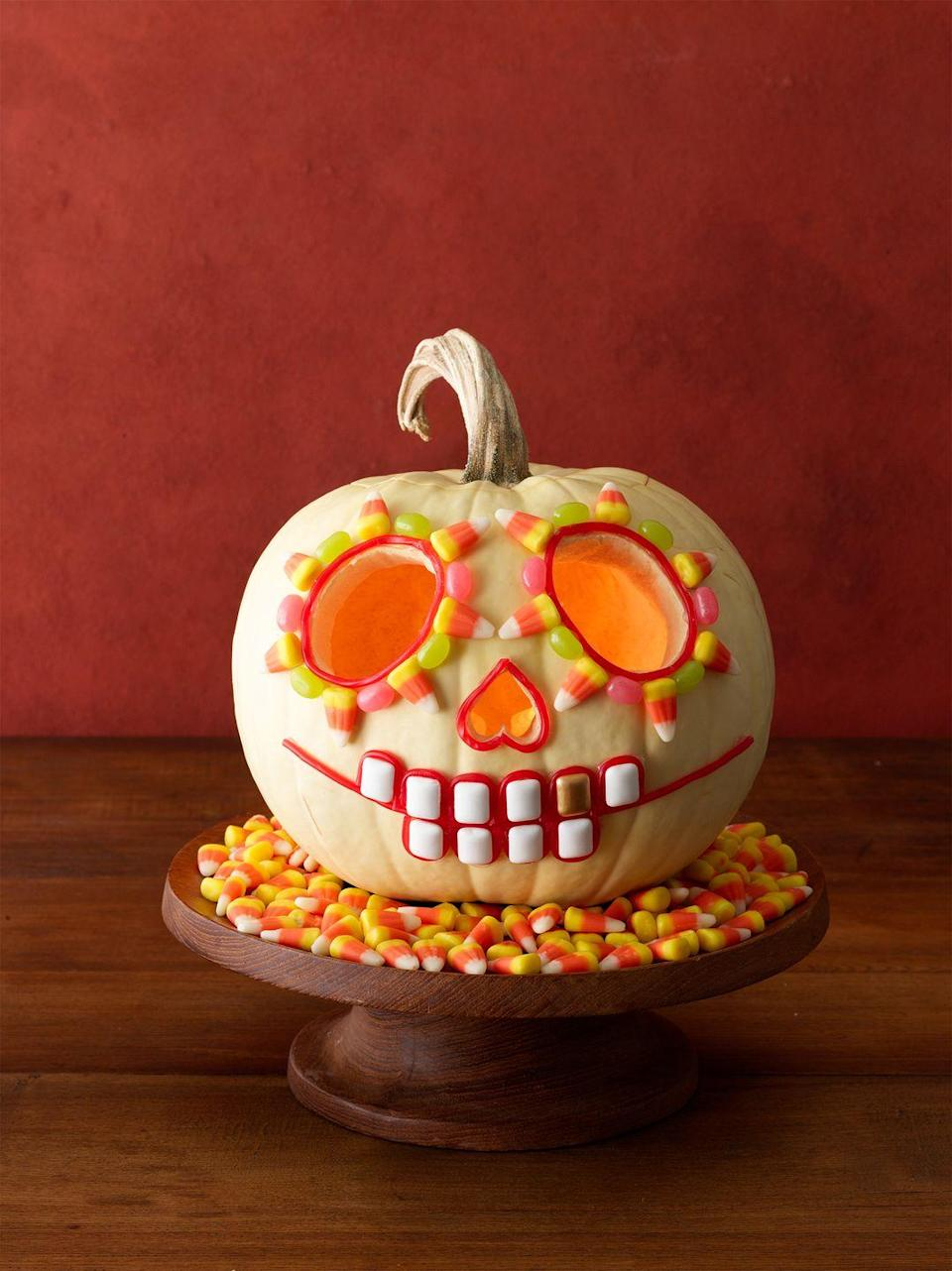 """<p>Can't figure out what to do with all of that candy corn? Put your extra Halloween candy to good use by decking out your pumpkin's carved face. </p><p><a class=""""link rapid-noclick-resp"""" href=""""https://www.amazon.com/Halloween-Candy-Corn-Brachs/dp/B07XHNG8VP/ref=sr_1_2?tag=syn-yahoo-20&ascsubtag=%5Bartid%7C10055.g.238%5Bsrc%7Cyahoo-us"""" rel=""""nofollow noopener"""" target=""""_blank"""" data-ylk=""""slk:SHOP CANDY CORN"""">SHOP CANDY CORN</a></p>"""