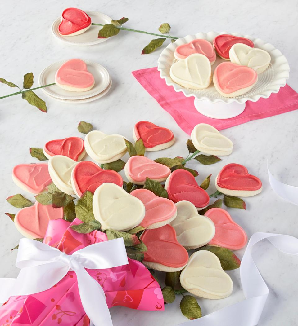 """<strong><h3>Buttercream Frosted Cookie Bouquet</h3></strong><br>A dreamy dozen of long-stemmed and heart-shaped sugar cookies covered in rich and fluffy buttercream frosting. <br><br><strong>Cheryl's Cookies</strong> Long Stemmed Buttercream Frosted Cookie Flowers, $, available at <a href=""""https://go.skimresources.com/?id=30283X879131&url=https%3A%2F%2Fwww.cheryls.com%2Fcheryls-long-stemmed-buttercream-frosted-cookie-flowers-vdy21-298301"""" rel=""""nofollow noopener"""" target=""""_blank"""" data-ylk=""""slk:Cheryl's Cookies"""" class=""""link rapid-noclick-resp"""">Cheryl's Cookies</a>"""