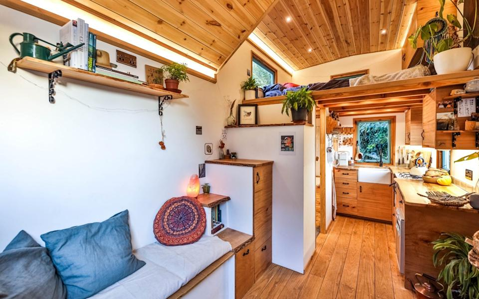 Hamer wanted to showcase these beautiful pieces of wood by letting the rustic aesthetic stand out against the white walls - Living Large in a Tiny House