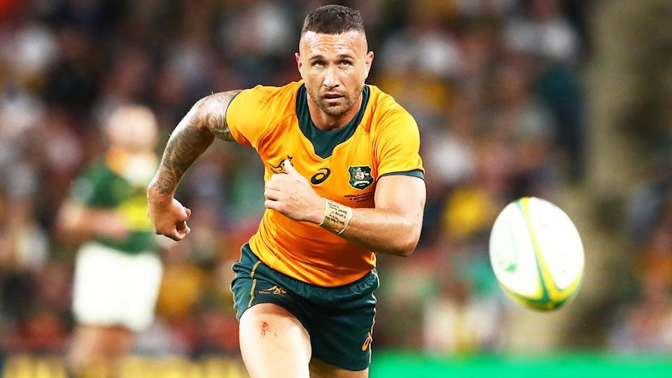 Quade Cooper (pictured) chases the ball against South Africa.