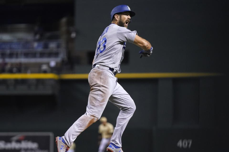 Los Angeles Dodgers' Steven Souza celebrates his home run against the Arizona Diamondbacks during the eighth inning of a baseball game Friday, June 18, 2021, in Phoenix. (AP Photo/Ross D. Franklin)