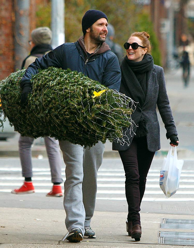 Julianne Moore and husband Bart Freundlich stopped by their local Christmas tree shop in NYC's West Village.