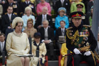 """In this image released by Netflix, Olivia Colman plays Queen Elizabeth II and Tobias Menzies portrays Prince Philip in a scene from the third season of """"The Crown."""" Britain's Prince Philip stood loyally behind behind Queen Elizabeth, as his character does on Netflix's """"The Crown."""" But how closely does the TV character match the real prince, who died Friday, April 9, 2021 at 99? Philip is depicted as a man of action in """"The Crown,"""" and he served with distinction in the navy in World War II. He was also an avid yachtsman and polo player.(Des Willie/Netflix via AP)"""