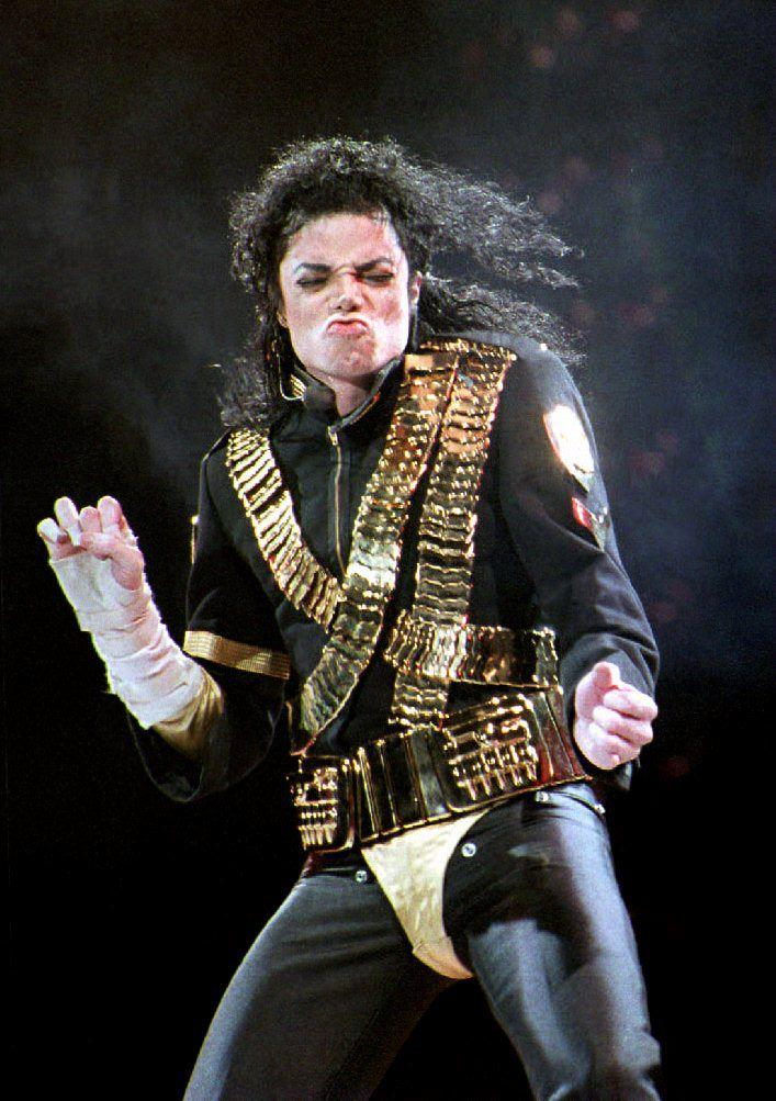 """(FILES) In this file photo taken on August 28, 1993 Pop star Michael Jackson performs the first of two concerts at the National Stadium in Singapore. - A new documentary that accuses Michael Jackson of sexually abusing two boys has been denounced by the late pop star's estate as an """"outrageous and pathetic"""" attempt to exploit his name.""""Leaving Neverland,"""" which is to premiere at the Sundance Film Festival later this month, recounts the story of two men who are now in their 30s and allege they were sexually abused by the King of Pop when they were seven and 10. (Photo by Roslan RAHMAN / AFP)        (Photo credit should read ROSLAN RAHMAN/AFP/Getty Images)"""