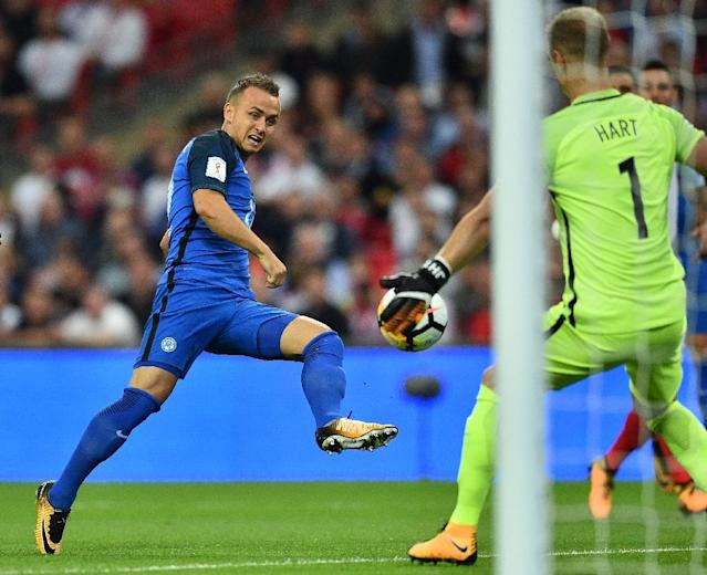 Slovakia's midfielder Stanislav Lobotka shoots past England's goalkeeper Joe Hart (R) to score the opening goal on September 4, 2017 (AFP Photo/Glyn KIRK)
