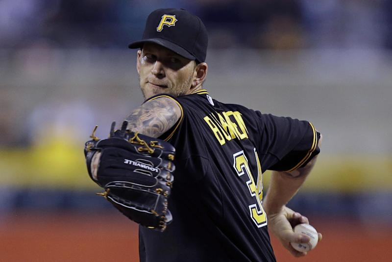 Pittsburgh Pirates starting pitcher A.J. Burnett (34) delivers during the first inning of a baseball game against the Cincinnati Reds in Pittsburgh Saturday, Sept. 21, 2013. (AP Photo/Gene J. Puskar)
