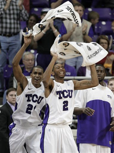 TCU 's Nate Butler, left, and Connell Crossland (2) celebrate off the bench as TCU tied the game against UNLV late in the second half of an NCAA college basketball game Tuesday, Feb. 14, 2012, in Fort Worth, Texas. TCU defeated UNLV in a 102-97. (AP Photo/Tony Gutierrez)