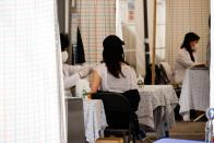 A woman gets an influenza vaccine at a hospital in Seoul
